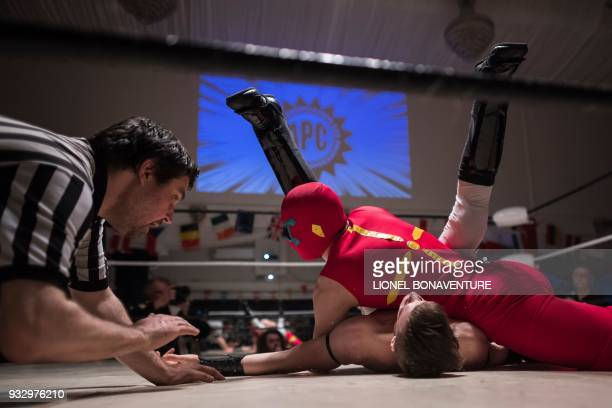 TOPSHOT Young wrestlers are pictured during a show on March 11 in Nanterre near Paris In Nanterre the French Association of Professional Wrestling...
