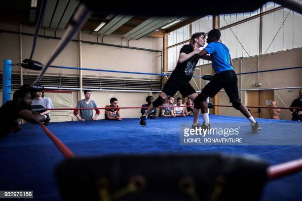 Young wrestlers are pictured during a training session on March 10 in Nanterre, near Paris. - In Nanterre, the French Association of Professional...