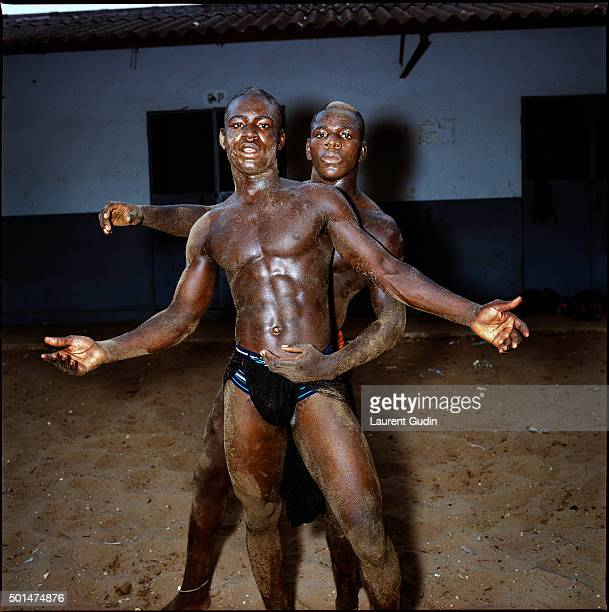 Young wrestlers from the Ndakaru stable at training in the Medina part of Dakar Senegal
