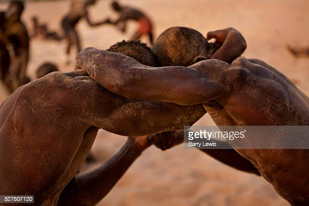Young wrestlers training on the sand in the village of Dionewar situated on a desert island in the mouth of the river Saloum Senegal No visit to...