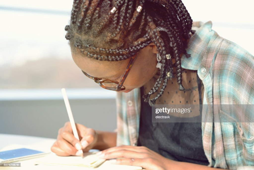 Young writer at work : Stock Photo