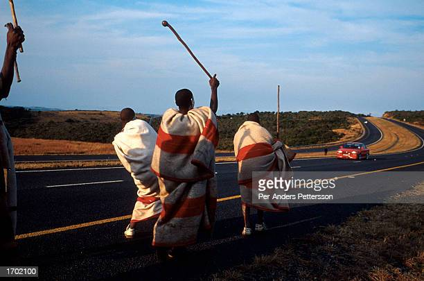 Young Xhosa boys dancing and singing traditional songs on the N2 highway on July 9, 2001 Mdantsane outside East London in Eastern Cape Province,...