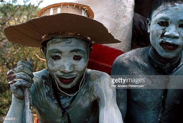 Young Xhosa boys sit in the bush while smeared in gray clay as part of a manhood initiation rite July 11 2001 in Mdantsane outside East London in...