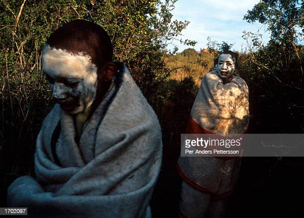 Young Xhosa boys walking in the bushes in early morning, after being circumcised a few days earlier on July 9, 2001 Mdantsane outside East London in...