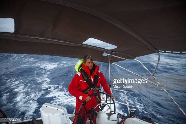 young yachtsman on the boat - atlantic islands stock pictures, royalty-free photos & images