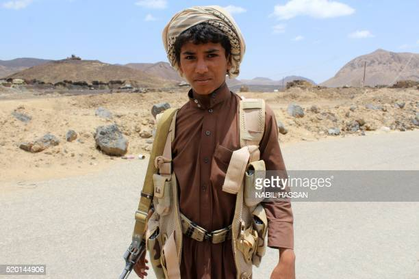 A young Yemeni fighter loyal to exiled President Abedrabbo Mansour Hadi poses in the Sirwah area in Marib province on April 9 2016 Loyalist forces...