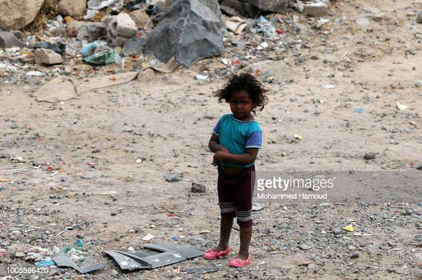 A young Yemeni girl who is displaced from Hodeidah stands alone outside a house where she lives on July 22 2018 in Sana'a Yemen
