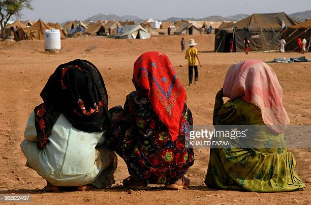 Young Yemeni refugees sit near tents at the Mazraq internally displaced people's camp in the northwestern province of Hajja on October 9 2009 UN...