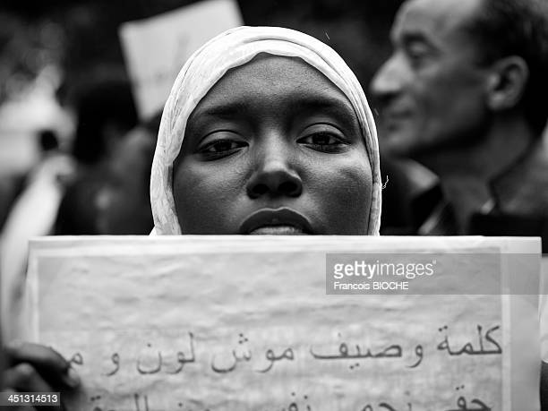 Young yoman protest against racism in Tunisia during march of labor's day in Tunis