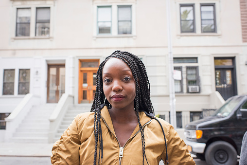 Young young woman in her city neighborhood - gettyimageskorea