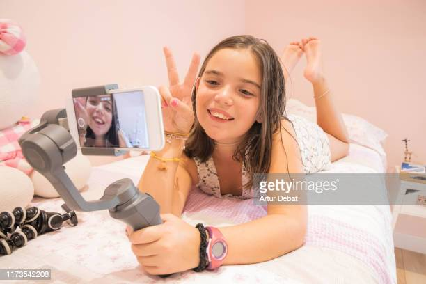 young youtuber girl recording video blog at home. vlogging. - influencer stock pictures, royalty-free photos & images