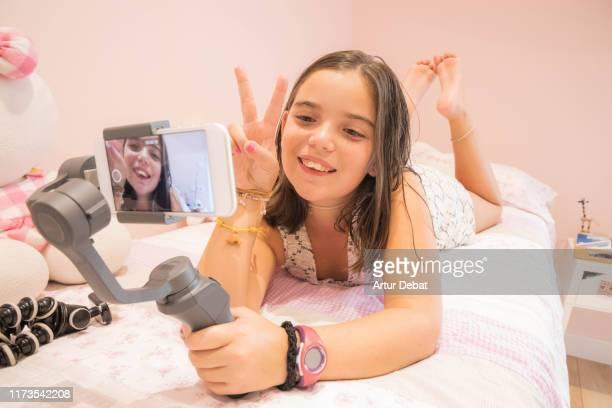 young youtuber girl recording video blog at home. vlogging. - influencer stockfoto's en -beelden