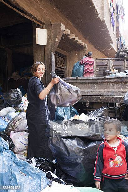 A young Zabaleen woman sorts through garbage collected from Cairo for useful items to recycle Moqqatam is a suburb on the edge of Cairo and home to a...