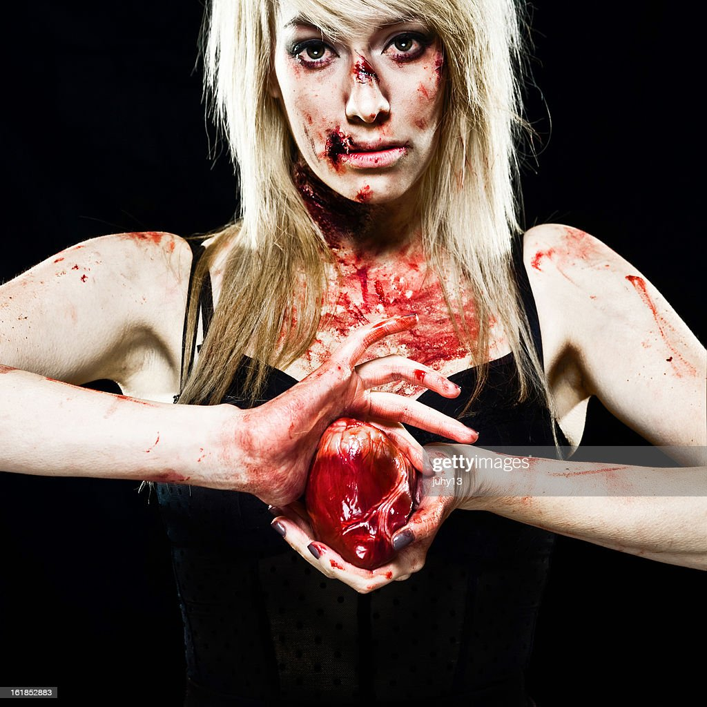 Young Zombie girl with a Human Heart : Stock Photo