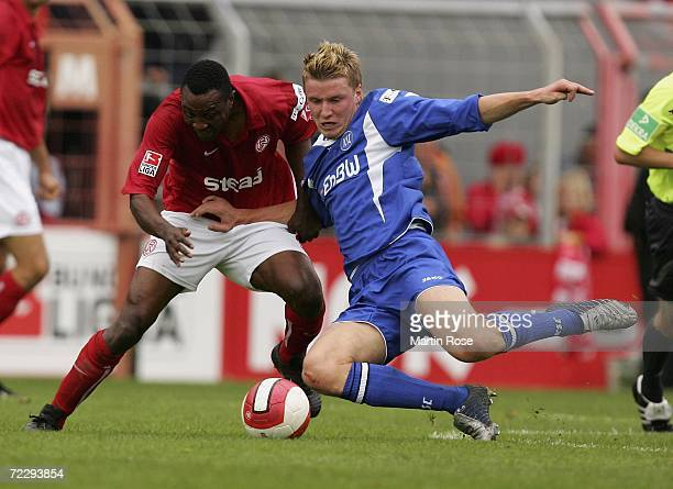 Younga Macchambes of Essen and Maik Franz of Karlsruhe fight for the ball during the Second Bundesliga match between Rot Weiss Essen and Karlsruher...