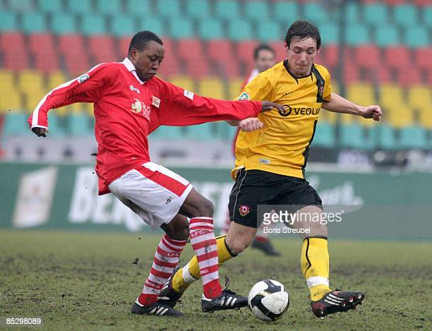 M YoungaMouhani of 1 FC Union Berlin battles for the ball with Maik Kegel of Dynamo Dresden during the Third Bundesliga match between 1 FC Union...
