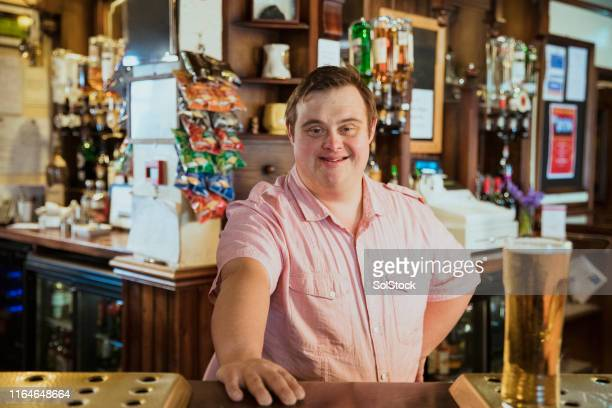 youngb man enjoying his job - persons with disabilities stock pictures, royalty-free photos & images