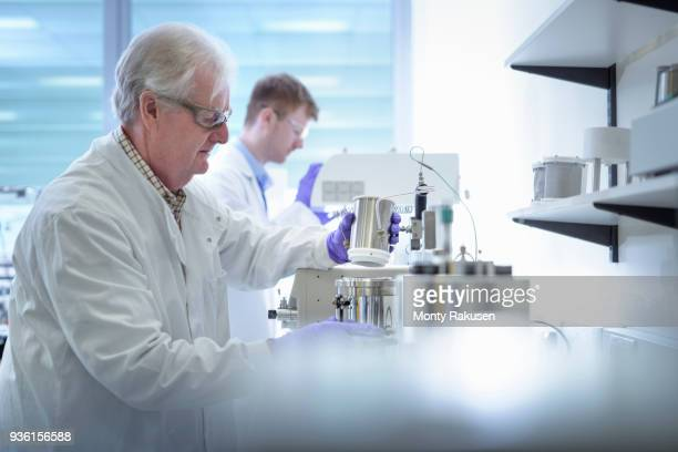 Younger and older scientists working in laboratory
