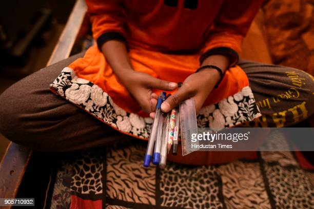Younger sister of the rapemurder victim holds stationary at her village at Jhansa village on January 16 2018 in Jind India A Class 12 student is the...