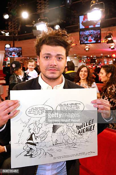 Youngest Main Guest of the Show Actor and Humorist Kev Adams shows the Original Draw of Asterix that Uderzo did for him during the 'Vivement...