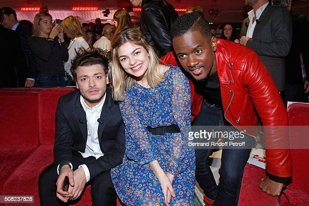 Youngest Main Guest of the Show Actor and Humorist Kev Adams Singer Louane Emera and Singer Black M alias Alpha Diallo attend the 'Vivement Dimanche'...