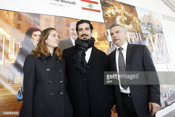 Youngest son of slain Lebanese Prime Minister Rafik AlHariri Fahd poses with his wife Maya and Lebanese photographer Ayman Trawi during the exhibit...