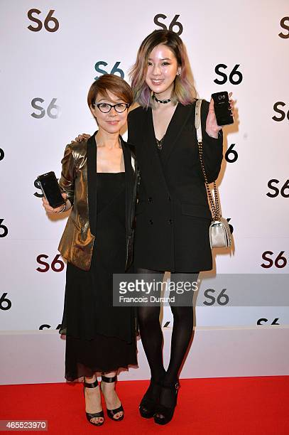 Younghee Lee and Irene Kim attend the Paris Fashion Week Tasting Night with Galaxy featuring Brad Goreski, model Jessica Stam and Executive Vice...
