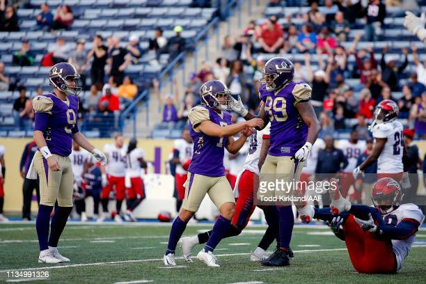 Younghoe Koo of Atlanta Legends is congratulated by his teammates Cameron Nizialek and Keith Towbridge after his 35yard gamewinning field goal to...