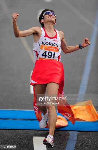 Youngjun Ji of Korea celebrates Gold during the Men's Marathon at Triathlon Venue during day fifteen of the 16th Asian Games Guangzhou 2010 on...