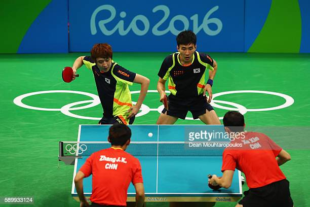Youngsik Jeoung and Sangsu Lee of Korea play against Jike Zhang and Xin Xu of China compete in the Men's Team Semifinal Badminton doubles on Day 10...