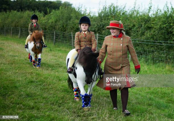 Youngster is led to the arena on her pony during the Osmotherley Country Show on August 5, 2017 in Osmotherley, England. The annual show hosts pony,...