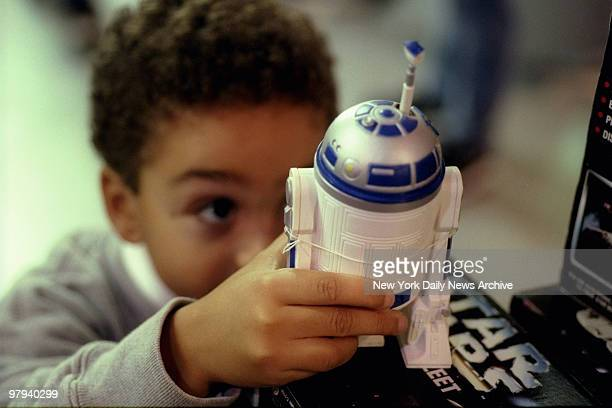 Youngster looks over Star Wars figure R2D2 at FAO Schwarz