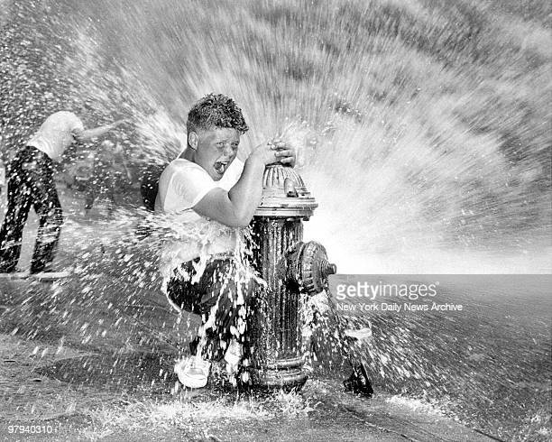 Youngster playing in water from fire hydrant Police are waging campaign against indiscriminate opening of hydrants since it reduces water pressure...