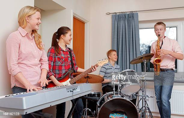 youngster playing music in group - rehearsal stock pictures, royalty-free photos & images