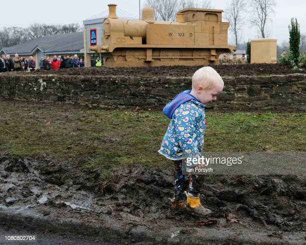 A youngster plays in the mud after former Royal Engineer and Dunkirk veteran David Evans from Leyburn unveiled a carved locomotive in the centre of...