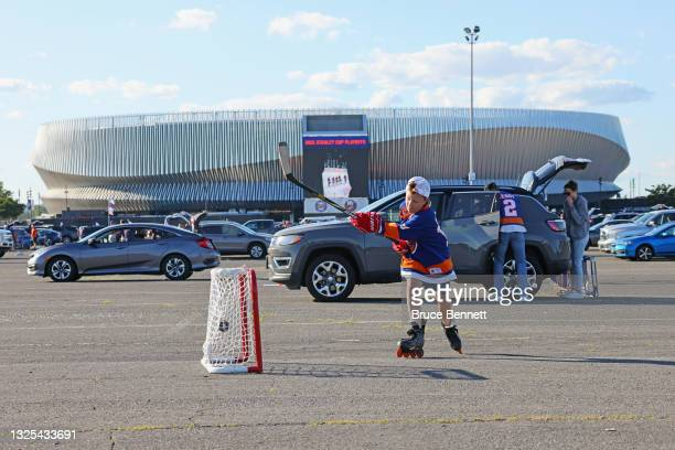 Youngster plays outside the arena prior to the game between the New York Islanders and the Tampa Bay Lightning in Game Six of the NHL Stanley Cup...