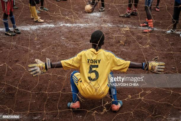 A youngster reacts before a football match during the HIV prevention event for youth organized by nongovernmental organisation 'I Choose Life Africa'...