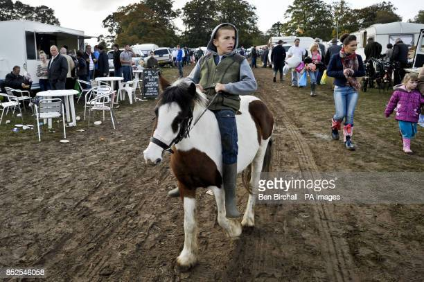 A youngster rides a horse bareback at the StowontheWold Horse Fair in Gloucestershire where members of the traveling community meet up and trade...