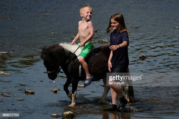 A youngster rides his horse along the River Eden on the first day of the Appleby Horse Fair on June 7 2018 in Appleby EnglandThe fair is an annual...