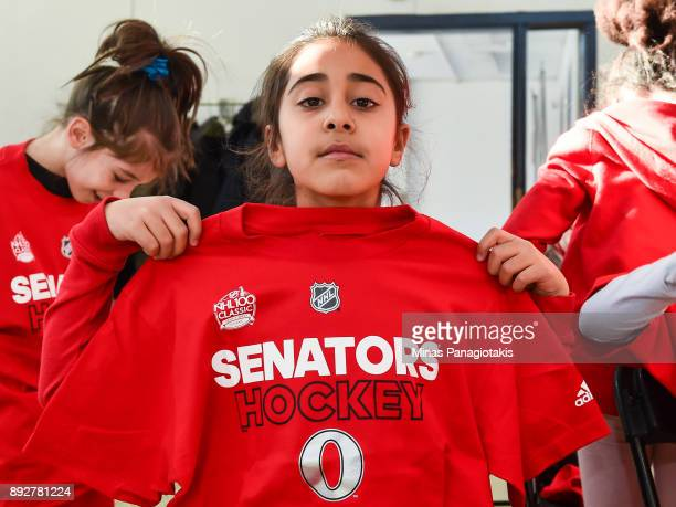 A youngster shows off her new Ottawa Senators shirt during the 2017 Scotiabank NHL100 Classic Legacy Project press conference at the Boys Girls Club...