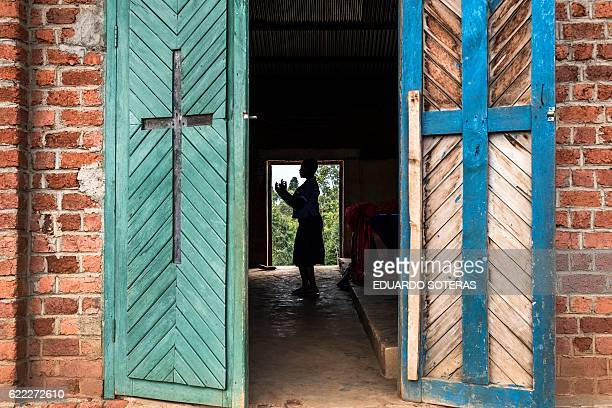 TOPSHOT A youngster sings inside the Mulamo Baptist Church in the Kyala neighbourhood of Butembo North Kivu province on November 10 2016 Tension...