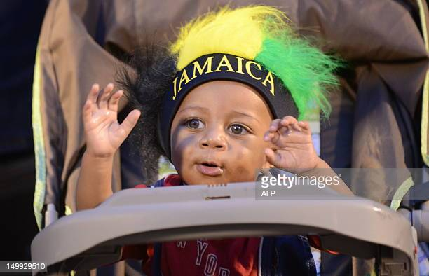 A youngster wearing the Jamaican colors during ceremonies August 6 2012 for the Jamaica 50th Independence Grand Gala celebration at the National...