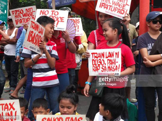 MENDIOLA MANILA PHILIPPINES Youngsters are seen holding placards during the protest Leftist groups stage Bonifacio Day of protest in Mendiola and at...