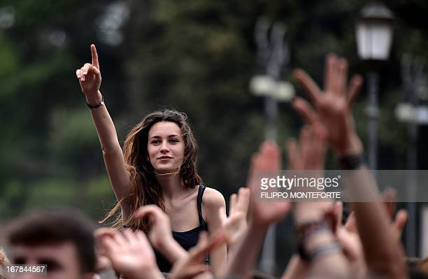Youngsters attend the 'workers' day concert' to celebrate Mayday in Rome's Piazza San Giovanni on May 1 2013 AFP PHOTO / Filippo MONTEFORTE