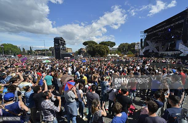 Youngsters attend the workers' day concert to celebrate Mayday in Rome's Piazza San Giovanni on May 1 2014 AFP PHOTO / ANDREAS SOLARO