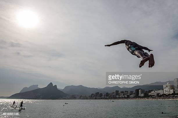 Youngsters enjoy diving into the sea at Arpoador beach in a temperature of 37 degrees Celsius in Rio de Janeiro Brazilon 16 January 2015 AFP PHOTO /...