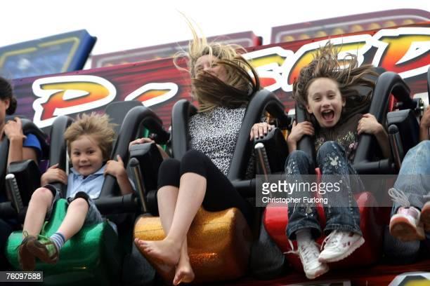 Youngsters enjoy the thrill of a fairground ride on 13 August Blackpool England The traditional British seaside holiday has managed to maintain is...