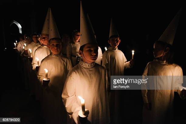 Youngsters from the Jarfalla chamber choir near Stockholm Sweden form part of the procession during the Swedish Sankta Lucia Festival of Light...