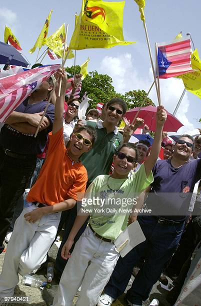 Youngsters join the celebration outside the Capitol Building in San Juan marking the 50th anniversary of the Puerto Rican constitution and the...