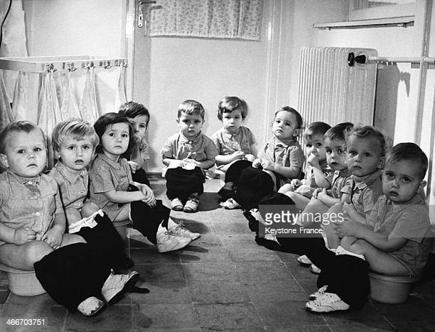 Youngsters of Kun Bela kindergarten in Dunaujvaros sitting on chamber pots in April 1970 in Hungary